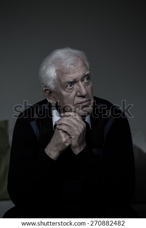 Portrait of older lonely man with depression - stock photo