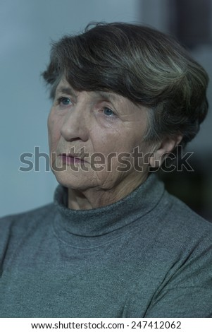 Portrait of older unhappy woman with depression - stock photo