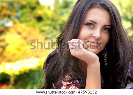 Portrait of one beautiful serene woman outdoor - stock photo