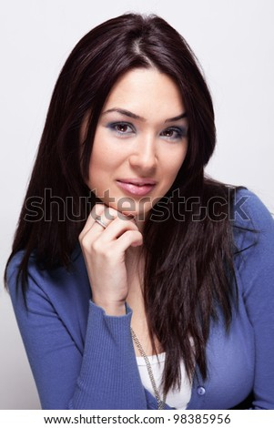 Portrait of one cute young woman in studio