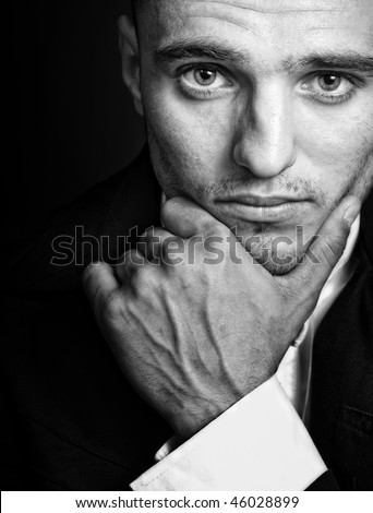 Portrait of one handsome elegant masculine young man - stock photo