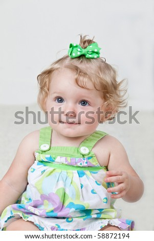 Portrait of one year old baby. - stock photo