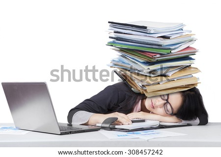 Portrait of overworked female worker sleeping on desk with paperwork over head, isolated on white - stock photo