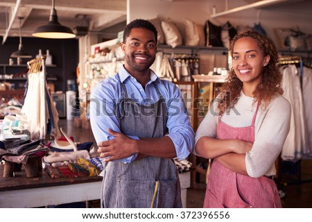 Portrait Of Owners Standing In Gift Store - stock photo
