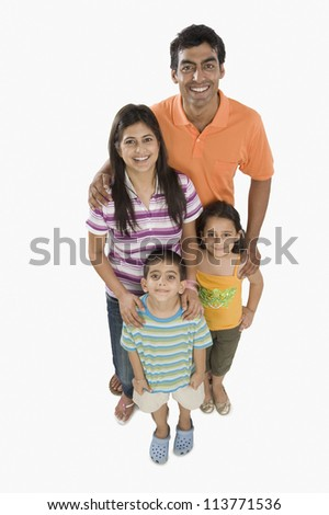Portrait of parents with their children smiling - stock photo