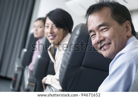 Portrait of passengers on airplane - stock photo