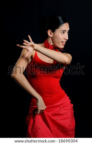 Portrait of passionate flamenco dancer isolated on black - stock photo