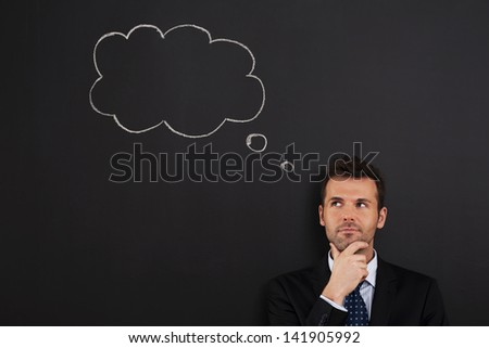 Portrait of pensive and thoughtful businessman   - stock photo