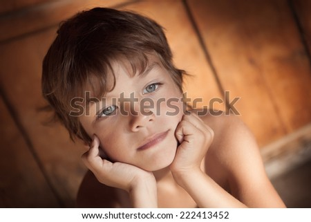 Portrait of pensive, serious boy - stock photo