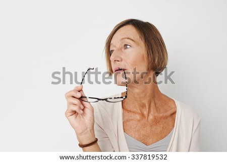 Portrait of pensive woman with glasses looking at the side - stock photo