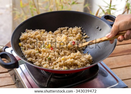 portrait of people cooking homemade spicy fried rice - stock photo
