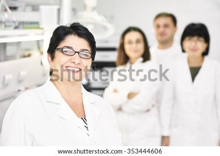 Portrait of pharmaceutical scientific research team  at pharmacy industry manufacture factory laboratory - stock photo