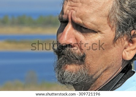 portrait of photographer working on the river on a sunny day in spring - stock photo