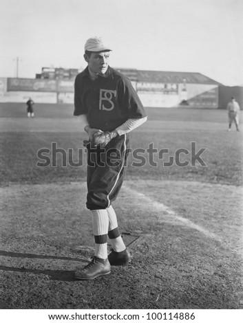 Portrait of pitcher on baseball field - stock photo