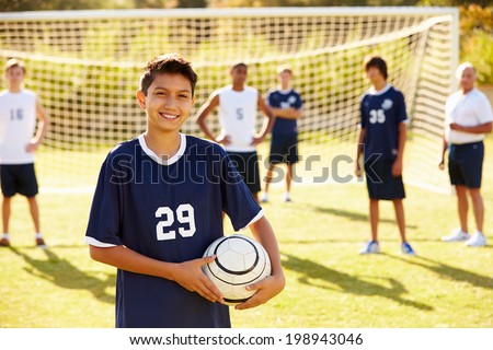 Portrait Of Player In High School Soccer Team - stock photo