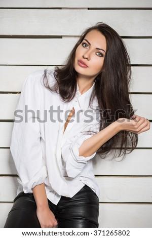 Portrait of playful brunette wearing white shirt - stock photo