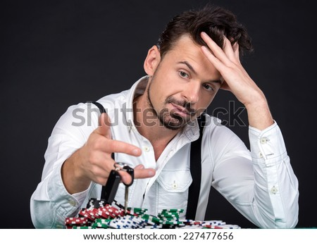 Portrait of poker player lost his car in the poker game. - stock photo