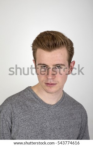 portrait  of positive looking young man isolated on white
