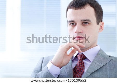 Portrait of positive well-dressed businessman - stock photo