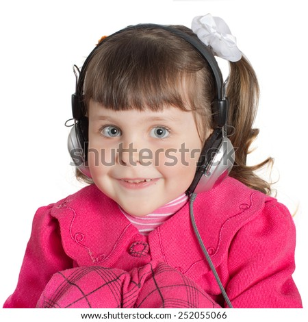 Portrait of preschooler girl in headphones. Charming child in pink dress on white background indoors. Studio shot. Isolate on white - stock photo