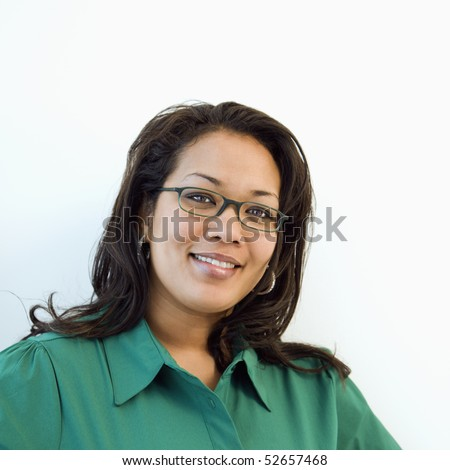Portrait of pretty African American businesswoman wearing eyeglasses and smiling. - stock photo
