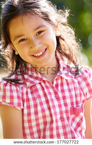 Portrait Of Pretty Asian Girl In Countryside - stock photo