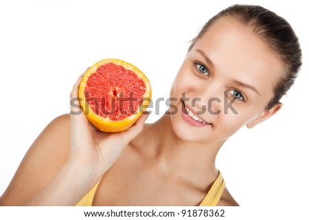 portrait of pretty attractive young woman holding fresh grapefruit, isolated on white background, attractive beauty girl with fruit - stock photo
