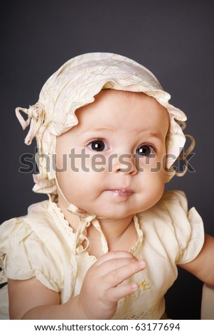 Portrait of pretty baby girl in hat, studio shot - stock photo