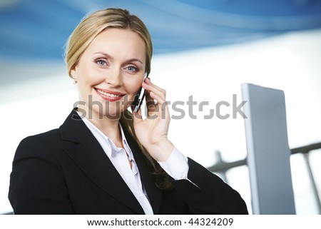 Portrait of pretty blonde calling and looking at camera
