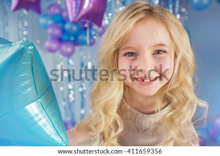 Portrait of Pretty blonde little girl with color balloons - stock photo