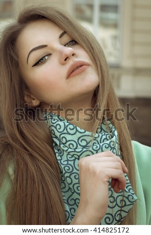 Portrait of pretty blonde woman at the street. Closeup shot - stock photo