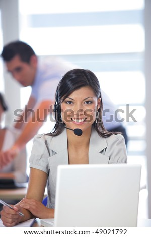 Portrait of pretty business woman with headset - stock photo