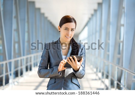 Portrait of pretty businesswoman on the modern background