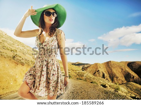 Portrait of pretty cheerful woman wearing hat - stock photo