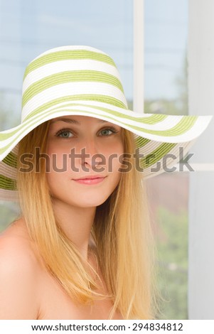 Portrait of pretty cheerful woman wearing straw hat in sunny . Vertical framing - stock photo