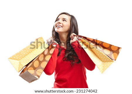 Portrait of pretty customer with paper shopping bags - stock photo