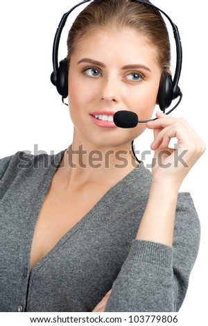 Portrait of pretty female call center employee wearing a headset, against white background - stock photo