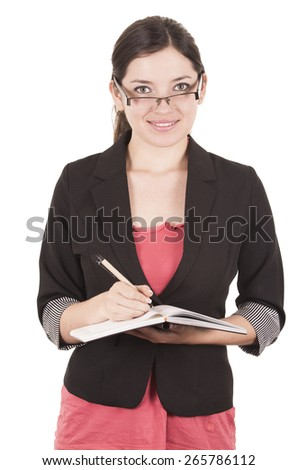 portrait of pretty female teacher wearing glasses and writing in notebook isolated on white - stock photo