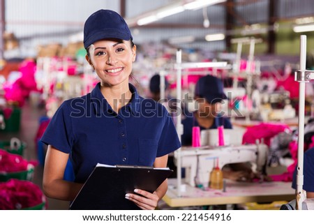 portrait of pretty female textile worker holding clipboard