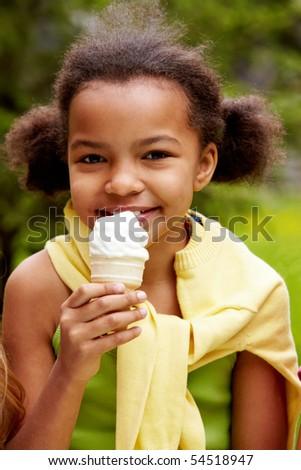 Portrait of pretty girl eating ice-cream - stock photo