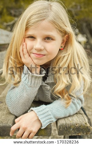 portrait of pretty girl on a bench