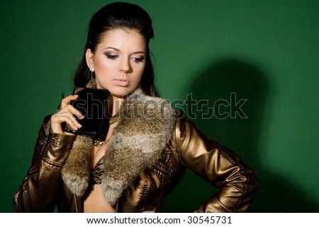 portrait of pretty girl on green with wallet