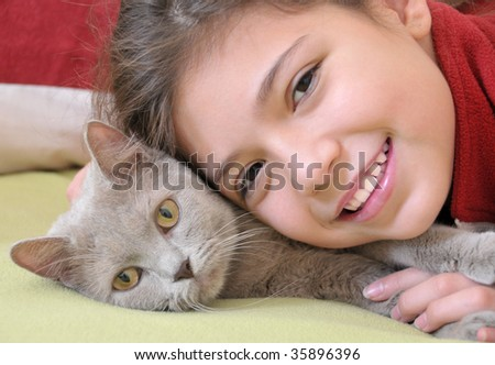 Portrait of pretty girl with cat - stock photo