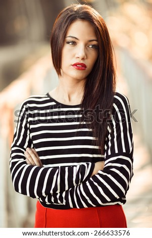Portrait of pretty girl with green eyes wearing young clothing - stock photo