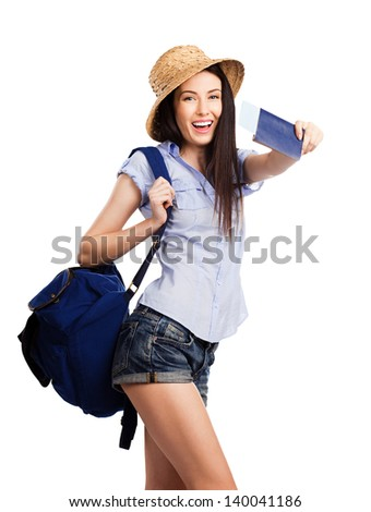 Portrait of pretty happy young student holding passport on holiday, on white background - stock photo