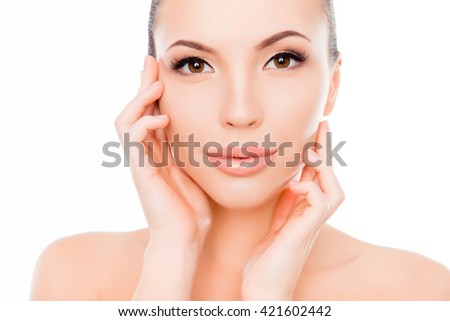 Portrait of pretty healthy woman touching her face - stock photo
