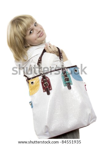 Portrait of pretty joyful girl holding stylish handbag - stock photo