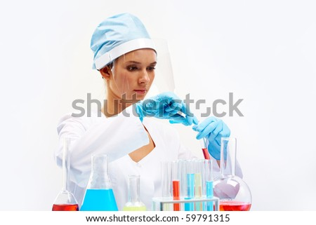 Portrait of pretty laboratory worker filling tube with substance - stock photo