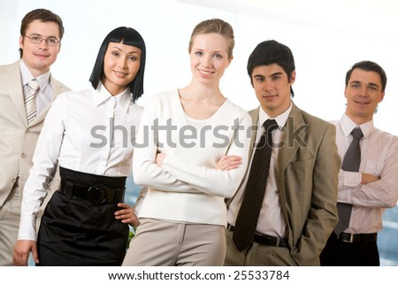 Portrait of pretty leader with business team on both sides surrounding her
