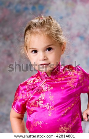 Portrait of pretty little girl on a painted background. - stock photo